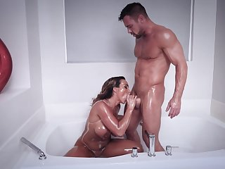 Muscular chap shows this busty MILF proper orgasms