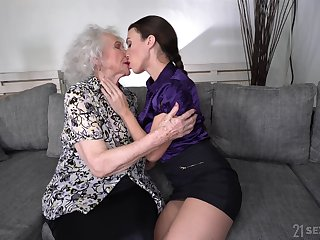 Young lesbian Tiffany Doll is licking pussy of well-disposed expecting granny