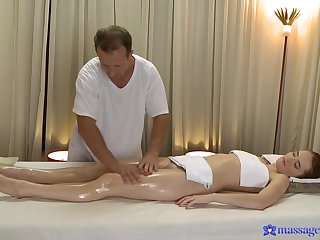 Sizzling redhead Denisa Heaven take captive to one's liking from a masseur