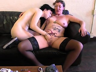 Mammy and a young of a female lesbian lube up and fuck toys