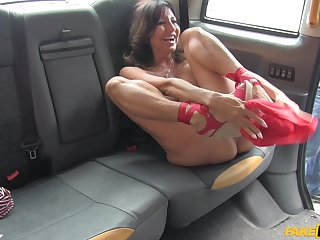 Busty grown up Tara Holiday flashes her big juggs nigh the taxi tweeny