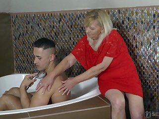 Old woman Irene helps one handsome young dude increased by gets her pussy fucked