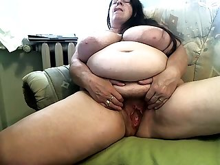 Fat hairy mature slut is working hard respecting make herself soaking on camera