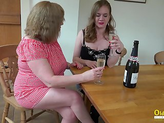 Two big housewives are licking puffed up pussies and fucking cucumber