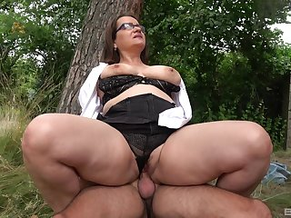 Big nuisance mature rides dick in a park together with swallows